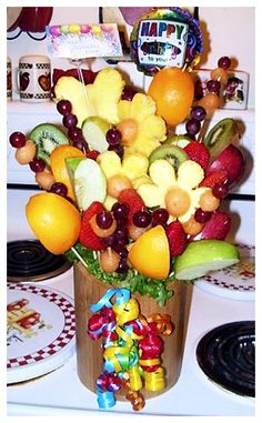 awesome Mouthwatering Fruit Flower Arrangement Check more at http://www.scentimentsflowers.com/mouthwatering-fruit-flower-arrangement/