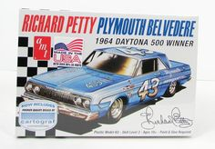This 1964 Plymouth Belvedere Richard Petty race car model kit is made by AMT in 1/25 scale. - Includes Cartograf decals - 426 cu. in. HEMI engine Brand new kit