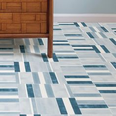 FloorPops Sleek and sophisticated, these peel and stick tiles will add intrigue to floors. The teal, turquoise and white geometric design has a fresh and soothing energy. Peel And Stick Floor, Peel And Stick Vinyl, Vinyl Tiles, Vinyl Flooring, Stick On Tiles, Luxury Vinyl Plank, Geometric Designs, Tile Floor, Home Improvement