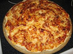 Yeast Free Pizza Dough  2 c. flour  1 t. salt  2 t. baking powder  2/3 c. water  1/4 c. vegetable oil  *I added some garlic salt to the crust mixture, to give it some extra flavor*    Mix flour, salt, baking powder and water. Knead on floured counter just until workable and spreadable, about 2 minutes. Put on pizza pan or stone, with fingers spread vegetable oil on crust. Bake at 425 degrees for 5 min.