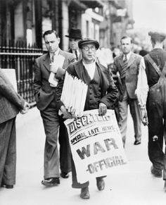 A newspaper seller carrying a placard announcing that Britain had declared war on Germany.THE HOME FRONT IN BRITAIN DURING THE SECOND WORLD WAR