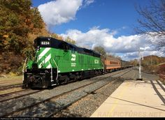 """MNTX (BN) SD9 #6234 with the """"Pumpkin Express"""" after switching cars for the weekend."""