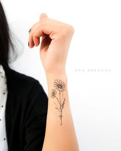 13 Flower Tattoo Ideas for Every Women Floral, Upper Wrist Tattoo Idea Aster Tattoo, Aster Flower Tattoos, Flower Wrist Tattoos, Sunflower Tattoos, Daisies Tattoo, Floral Tattoos, Wrist Tattoos For Women, Tattoos For Guys, Tattoo Women