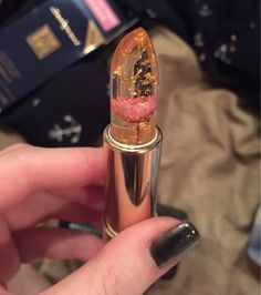 Gold flake flower lipstick.