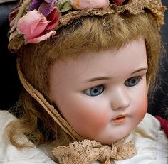 Antique doll with a beautiful hat!