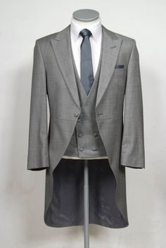 """Better, has more of an angular look.   grooms wedding tails suit grey fleck slim fit in light weight wool with double breasted waistcoat. Mens sizes from 32"""" chest upward and include extra short, short"""