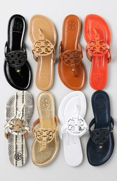 Obsessing over this breezy, cleanly styled flip-flop by Tory Burch that features a bold logo cutout across the instep.