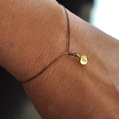 Hand stamped wish bracelet. Tiny Gold charm on  waxed Irish linen cord