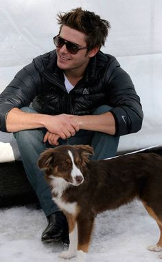 Zac Efron and a Dog from Zac Efron and Animals  This is where the dog streak of the gallery begins: Dog No. 1 is a dog that Zac Efron met in Aspen, Colo. This doggy may be playing it cool right now, but we're guessing it got a pet or two from Zac. And that is why we would give anything to be this dog.