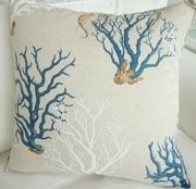 """Mediteranean Blue Coral Pillow. A beautiful pillow made from European fabric. The background is a nice shade of tan ( it almost looks like linen) with deep blues and whites. Print has blue Coral and white Coral with a small Seahorse. This Pillow measures 22""""x22""""."""