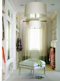 Dream closet. Those cream drum shades with the metallic interiors and the aqua leopard ottoman — love.  (via pinterest)