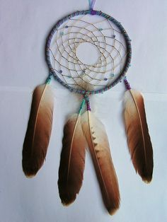 Blue Purple and Gold Dreamcatcher with Swarovski Crystal and Red-Tailed Hawk Feathers by Rainbow Dreamcatchers, via Flickr
