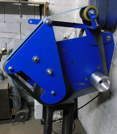 belt grinder with revolving contact wheel unit;