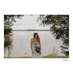 Beautiful Lori enjoying the hour of no rain we had on her wedding day! One of the best weddings ever. #lacdubonnet #lakelife #cabinlife #ceremony #manitoba #weddings #weddingdetails #details #prairies #bride #spring #weddingvenue #blfstudios #weddingmoments #love #weddingday
