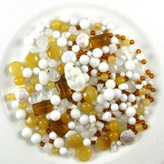 The bead mix is a lovely mix of milk and honey and amber colored stones, including genuine gemstones in honey jade, white jade, snow jade, opals and freshwater pearls in a vareity of shapes: rounds, chips, coins and teardrop, plus amber-colored seed beads and large faceted Czech glass rectangles. Perfect for a mother who plans to nurse her baby!
