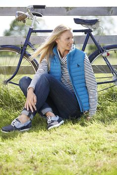 NEW from Toggi for the SS15 season, model wears the Cassie padded gilet in Topaz Blue along with our Capri ladies deck shoes. A perfect outfit for a sunny bike ride