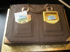 Bookbag Cake - Chocolate cake with mock whipped cream icing covered in Satin Ice fondant.  Books and tracts are fondant covered in edible images.  11 X 15 - two layers.