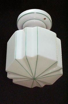 Green stripe porcelain ceiling fixture with original fitter    http://www.vintagelights.com/product/1/vintage-original-green-striped-globe-and-matching-porcelain-fitter.html