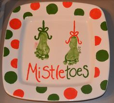 "I used my 4 month old's foot prints to decorate a ""Mistletoes"" square charger plate. My child's name is written along the left side of the left foot (I blurred it for privacy). I actually used bottle lids to trace the circles and then painted them. Made this at my local ceramic shop. So much fun to do!"