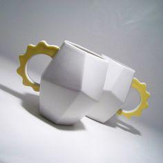 white and yellow coffee mugs