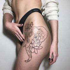 Linework and dotwork elephant and Lotus blackwork flower tattoo
