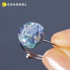 15 , Basteln , Leni Kelle , Easy DIY Planet Ring💍 A Small Universe on your Finger💍 By: Source by . Resin Jewelry Tutorial, Resin Jewlery, Diy Jewelry Rings, Making Resin Jewellery, Jewellery Display, Jewelry Crafts, Resin Ring, Resin Necklace, Diy Resin Art