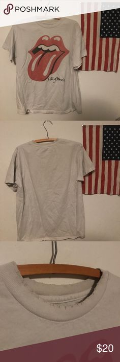 Brandy Melville Rolling Stones Rock Shirt Barely worn Brandy Melville shirt featuring a faded Rolling Stones graphic. Shirt is off-white and has nibbled hemlines (see picture). One size, but would fit a medium comfortable. Comment with any questions! Brandy Melville Tops Tees - Short Sleeve