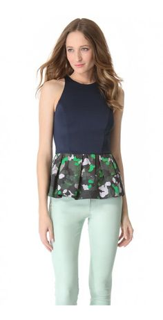 SLICE OF LIGHT PEPLUM TOP $320.62 SPECIAL $48.09 YOU SAVE: 85% NOTE: Sizes listed are Australian. Please see Size & Fit tab.  A camouflage peplum flares from the hem of a curve-conforming jersey top, balancing the fitted silhouette with a flattering touch of volume. Hidden back zip. Lined.
