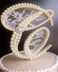 Pearls of Wisdom on itsabrideslife.com/Pearl Wedding Decor/Pearl Wedding Ideas/Pearl Cake Toppers