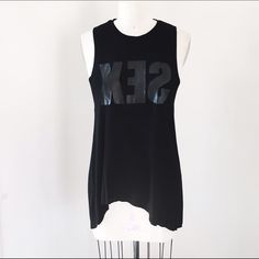 "STYLESTALKER XES Tank Stylestalker XES Tank  Retail Price: $70  NWT  Size: S (can fit a M too)  Color: Black on Black (white picture for fit reference only)    Supersoft jersey muscle tee with ""Sex"" reflected, low cut raw edge armholes, subtle high low hem and godet inserts at the sides for a little more flow and flare to the tank.    L25-29  B37  H48 Stylestalker Tops Tank Tops"