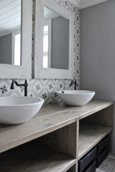 Double sink and patterned tile in bathroom