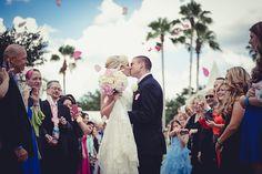 Picture perfect ceremony exit rose petal toss at Disney's Wedding Pavilion