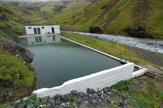 Seljavallalaug The oldest (maybe) swimming pool in Iceland is a stunning oasis built into the side of a lush hill.