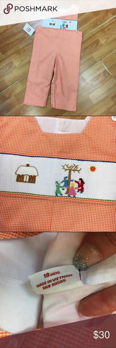 Mom & Me NEW NWT Gingham Smocked Romper 18 Mo Mom & Me NEW NWT Gingham Smocked Romper 18 Mo  Smocked with a winter scene of children dancing around a tree next to a snow covered house.  Ya' got me!  Snaps around legs, buttons on shoulders.  #new #nwt #gingham #orange #white #check #checks #checkered #smocked #romper #playsuit #onepiece #jumper #sosouthern #winter #momandme Mom & Me One Pieces
