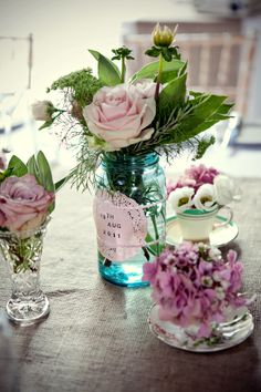 This gave me an idea...use clear vases with white flowers.  Each will have a pretty tag with favorite bible verses you and Rustin have picked out...mainly verses that relate to marriage