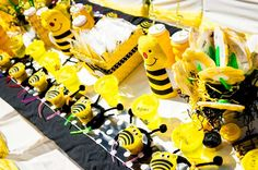 Yellow and black party table at a bumble bee first birthday party! See more party planning ideas at CatchMyParty.com!
