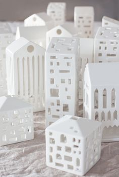 Designed by Mette Bache and Barbara Bendix Becker for KÄHLER (Danish Company) - ceramic with a fine white glaze - Candle Holder - Urbania Series Lanterns. (****I, also, found these at http://moddea.com/2012/12/10/urbania-lighthouses/)