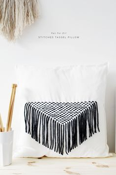 Dress up a plain pillow with fabulous fringe! DIY Stitched Tassel Cushion by Fall For DIY. Great for scraps - try it with Wool-Ease or Vanna's Choice!