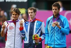Best of the best: Murray parades his gold with Federer and Juan Martin del Potro, who beat Novak Djokovic to take bronze