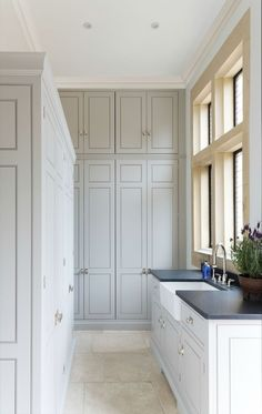 Floor To Ceiling Laundry Room Cabinets - Design photos, ideas and inspiration. Amazing gallery of interior design and decorating ideas of Floor To Ceiling Laundry Room Cabinets in laundry/mudrooms by elite interior designers. Grey Laundry Rooms, Laundry Room Cabinets, Laundry Room Design, Kitchen Design, Kitchen Cabinets, Cupboards, Layout Design, Design Ideas, Design Inspiration