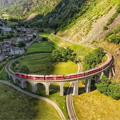 living_europeThe train of fairytales  ~ Brusio Spiral Viaduct, Switzerland    Photo: @hugocm1