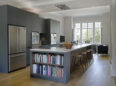 Roundhouse Urbo matt lacquer bespoke kitchen with built-in book storage