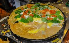 Crepe Florentine - Creperie Catherine - Ingredients: Spinach, Egg, Feta, Swiss Cheese, Tomatoes, Onions, Bechamel. #recipe