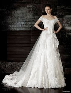 Intuzuri 2013.  Aracelia off-shoulder gown with sheer peplum overskirt.