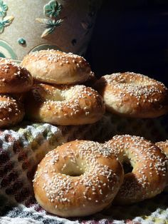 THIBEAULT'S TABLE: SOURDOUGH BAGELS ==  I have used this recipe for over 20 years. I have tried other recipes but this is my favourite one. ==2 cups warm water ,2 pKG active dry yeast, 3T sugar,1T salt, 5 3/4 cups all-purpose flour, 3 quarts water with 1T sugar, Cornmeal 1 egg yolk beaten with 1T water,2T poppy or sesame seeds. ==SOURDOUGH OPTION==2oz starter,1 1/2c flour,1c water, ==ONION CHEESE BAGELS== sauted some onions in butter just until tender. Not brown.