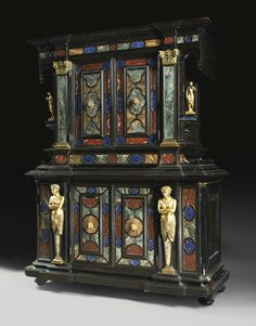 AN ITALIAN BAROQUE STYLE ORMOLU AND HARDSTONE-MOUNTED EBONIZED CABINET PROBABLY FLORENCE, MID-19TH CENTURY mounted with a great variety of hardstones including onyx, lapis lazuli, red griotte, campan pink and green, Sienna, tiger blue, and sarrancolin.. Sotheby's
