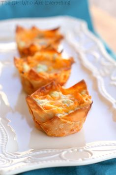 Buffalo Chicken Cupcakes buffalo-chicken-cupcakes – These are a great football food.  If you do cupcakes, I'd do the mini ones - they were a little time consuming, but cute.  I also just rolled them up like a taquito and baked - much easier, and I think I liked them a little better.