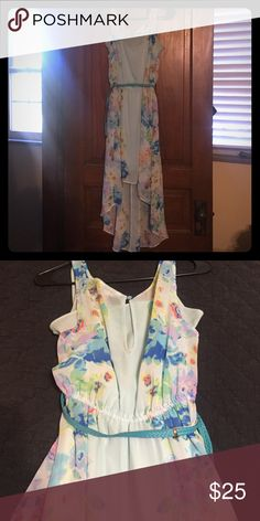 Candies hi-low floral print dress Beautiful hi-low teal and floral print dress by Candies. Only worn a few times. Juniors size large which would fit like a women's medium. Candie's Dresses High Low