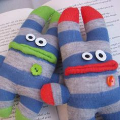 red and green sock monster brothers