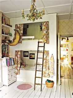 If you have a high ceiling look what you can do in that bedroom.  Use the top bunk as a indoor tree house for the kids reading nook.  Decorate accordingly for boy or girl.  Notice the chandelier that has been covered in silk vine.  Use camouflage material for a boy's reading nook.